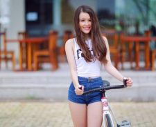 Asian Beautiful Girl Bicycle Outsine Coffee Shop