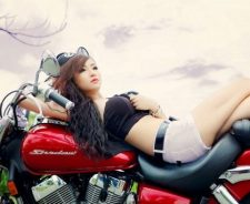 Asian Girl Lying On Bike Seat White Shorts Bra