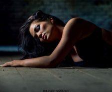 Black Brea Girl On Wooden Floor Low Light Room