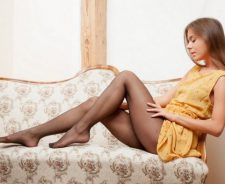 Blonde Girl On Sofa Black Stockings Dress Pulled Up