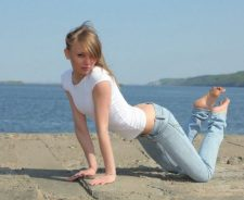 Blonde On All Fours In Jeans