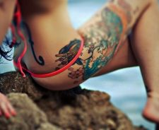 Colorful Large Tattoo Ass On Rock Pink Bikini Girl
