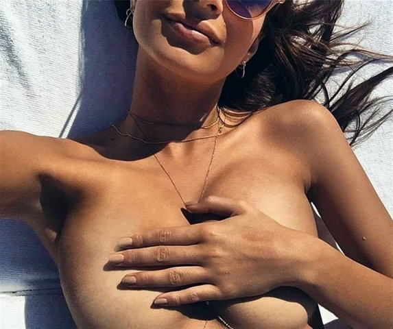Emily Ratajkowski covering her boobs with hands
