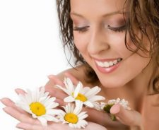 Girl Smiling With Flowers