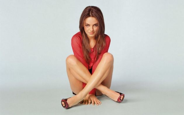 Mila Kunis Sitting On Floor Smiling