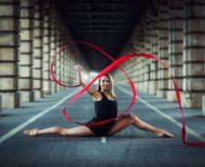 Red Ribbon Girl Gymnast Black Dress Legs