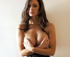 Rosie Roff holding her breasts