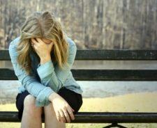 Sad Woman Sitting On Bench Image