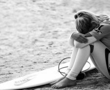 Sexy Surfer Sadness Showing Surfboard