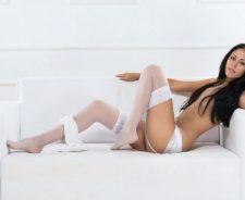 Skinny Body Brunette Sofa Dress Pulled Down Stockings