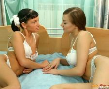 Two Lesbians Kissing In Bed