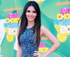 Victoria Justice Smiling In Front Of Colourful Wall